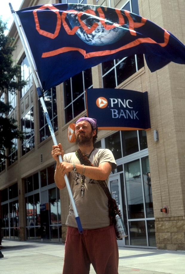 Protester in front PNC bank